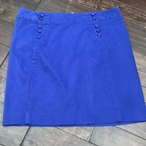Blue corduroy skirt with buttons.